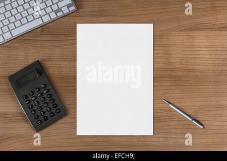 Blank sheet on a wooden table with modern keyboard calculator and silver pen - Stock Photo