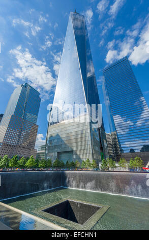 North Pool of National September 11 Memorial with One World Trade Center ('Freedom Tower') behind , New York City, - Stock Photo