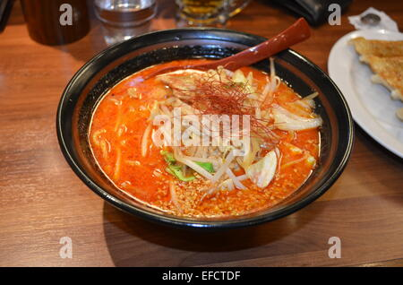 Dandan noodles or  dan dan mian is a noodle dish originating from Chinese Sichuan cuisine. - Stock Photo