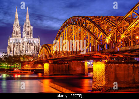 Cologne, Germany old town skyline at Cologne Cathedral and Hohenzollern Bridge. - Stock Photo