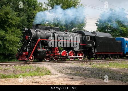 Steam locomotive series L as part of a retro train. - Stock Photo