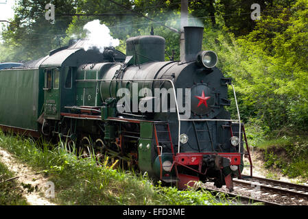 Steam locomotive series E as part of a retro train. - Stock Photo