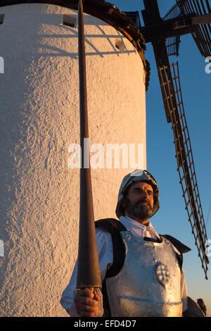 A citizen of Campo de Criptana dressed as Don Quixote, participates in an event at windmills - Stock Photo