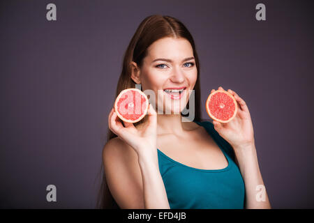 Woman with grapefruit - Stock Photo
