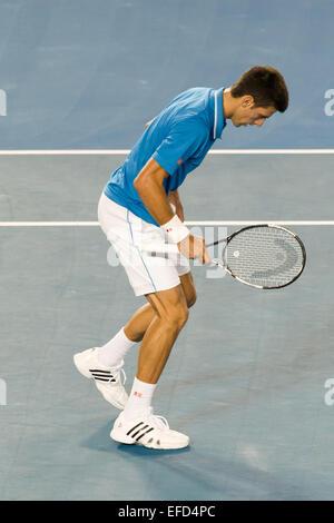 Melbourne, Australia. 1st Feb, 2015. 1st seed Novak Djokovic (SRB) stumbles in the Men's Final match against 6th - Stock Photo