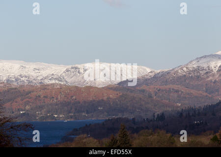 Lake Windermere, Cumbria, UK. 1st February, 2015. Nothern end of Lake Sunny but very cold day & snow on the high - Stock Photo
