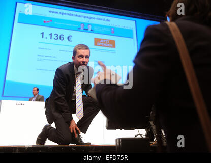 Bremen, Germany. 01st Feb, 2015. AfD party founder Bernd Lucke kneels at the side of the stage during the 3rd federal party conference of the Alternative fuer Deutschland (AfD) party in Bremen, Germany, 01 February 2015. The three-day party conference ends in the afternoon. PHOTO: INGO WAGNER/dpa/Alamy Live News