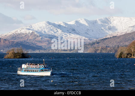 Lake Windermere Cumbria UK 1st February 2015 Boat trips on the Lake with snow covered fell 'Fiairfield Horseshoe' - Stock Photo