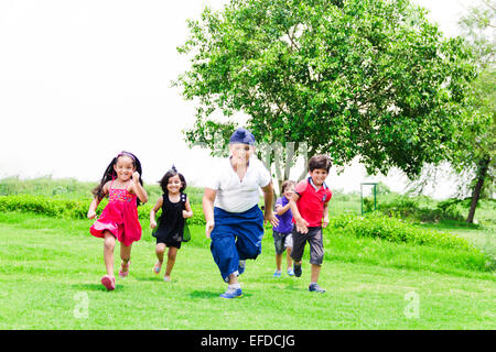 indian children group crowds friends Park Running - Stock Photo