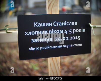 Crosses placed by activists and bearing the names of 30 people who died in shelling in Mariupol on Jan, 24 are seen - Stock Photo
