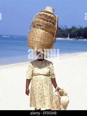 Woman basket seller on beach, Sandy Lane Beach, Saint James Parish, Barbados, Lesser Antilles, Caribbean - Stock Photo