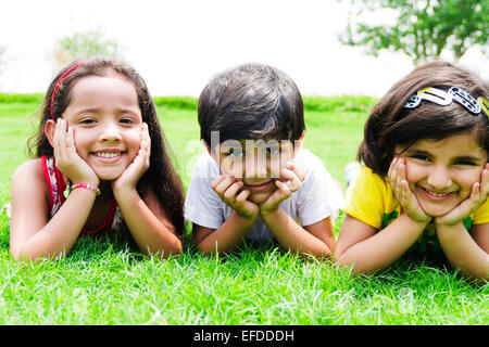 3 indian children friends park enjoy - Stock Photo