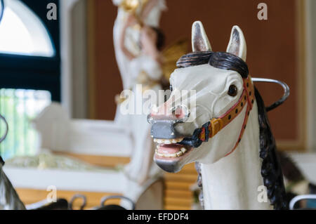 Traditional wooden horse on a carousel at Vidam Park (Holnemvolt Park), Budapest - Stock Photo