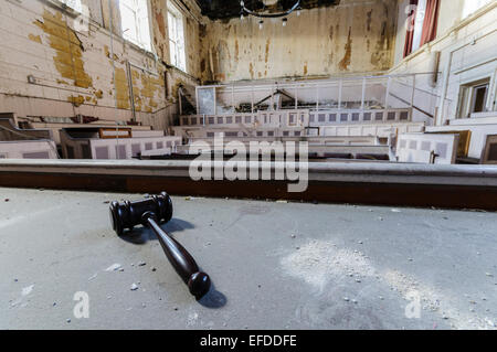 Gavel lying on the judge's bench inside the derelict Crumlin Road courthouse, Belfast - Stock Photo