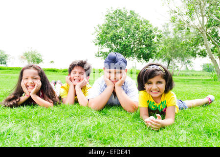 4 indian children friends park enjoy - Stock Photo