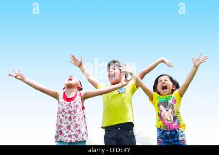 3 indian children friends Park Mischief - Stock Photo