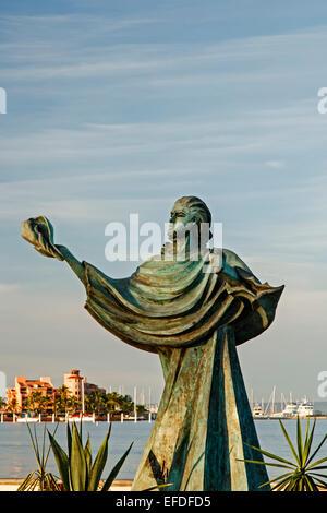 Sculpture of person holding a shell and bay,  Malecon (seaside promenade), La Paz, Baja California Sur, Mexico - Stock Photo