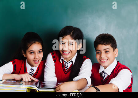 3 indian school friends students book Study - Stock Photo