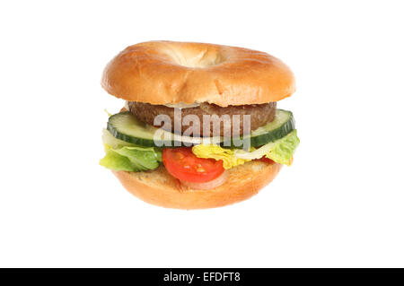 Beef burger with salad garnish in a bagel isolated against white - Stock Photo