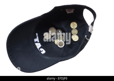 Euro coins in a cap on white background. Cut out. - Stock Photo