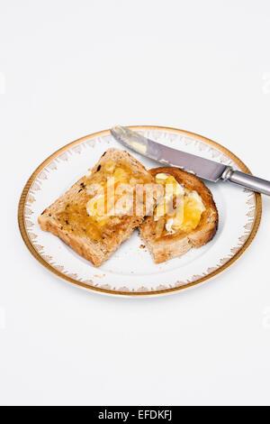 Toast and Marmalade. - Stock Photo