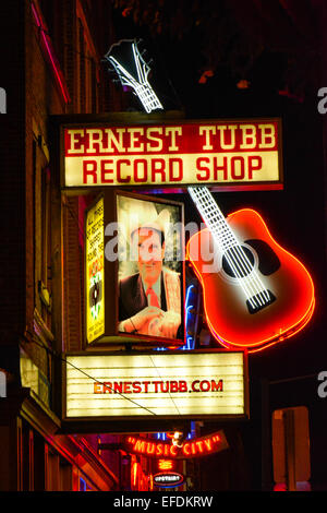 A night shot of the famous Ernest Tubb Record shop's Neon sign on Lower Broadway in downtown Nashville TN, Music - Stock Photo