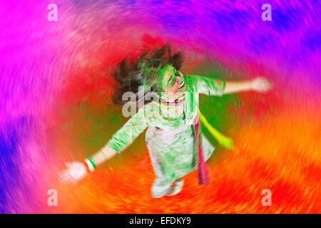 1 indian lady Holi Festival enjoy - Stock Photo