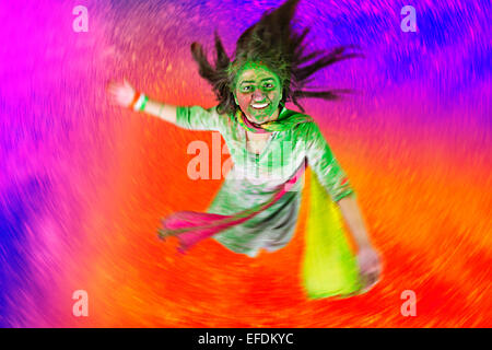 1 indian lady Holi Festival enjoy - Stock Photo