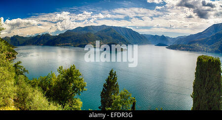 High Angle Panoramic View of Lake Como Towards Bellagio and Lenno from Castle Vezio, Varenna, Lombardy, Italy - Stock Photo
