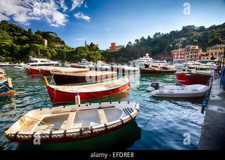 Small Boats Anchored in Portofino Harbor, Ligurria, Italy - Stock Photo