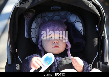An eight month old baby girl in a stroller.  Photo Tim Clayton - Stock Photo