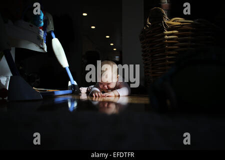 An eight month old baby girl at play.  Photo Tim Clayton - Stock Photo