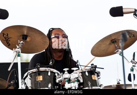 Black / African American drummer behind drum set on white background - Stock Photo