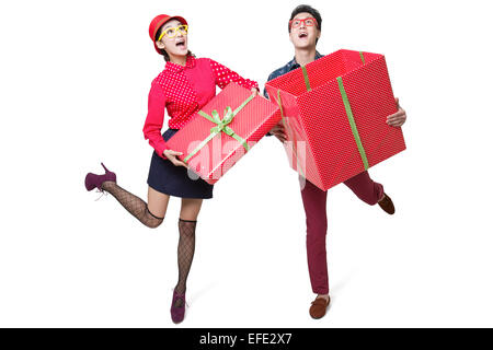 Young couple holding large gift box - Stock Photo