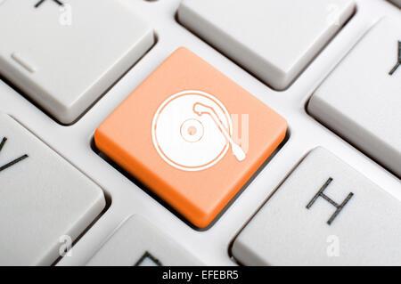 Gramophone record key on keyboard - Stock Photo