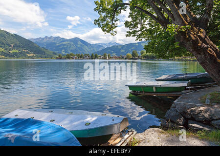 Metal covers on the boats on the lake with mountains in the background at Zell am See Austria in summer - Stock Photo