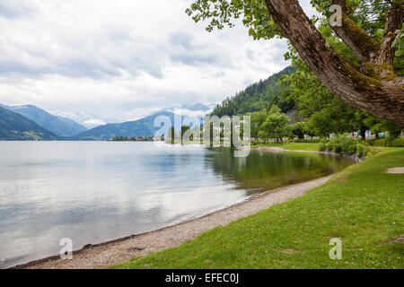 The lake with mountains in the background at Zell am See Austria in summer - Stock Photo