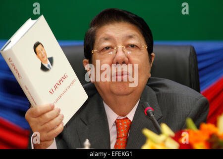 Phnom Penh, Cambodia. 2nd Feb, 2015. Cambodian Deputy Prime Minister and Cabinet Minister Sok An shows the book - Stock Photo