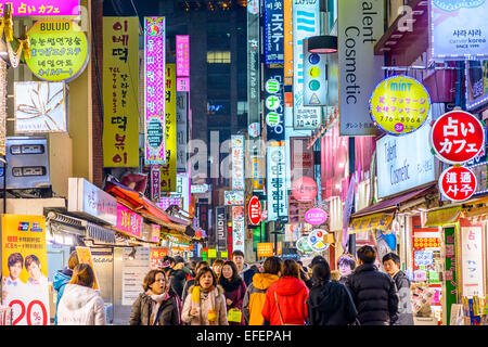 Crowds enjoy the Myeong-Dong district nightlife in Seoul. - Stock Photo
