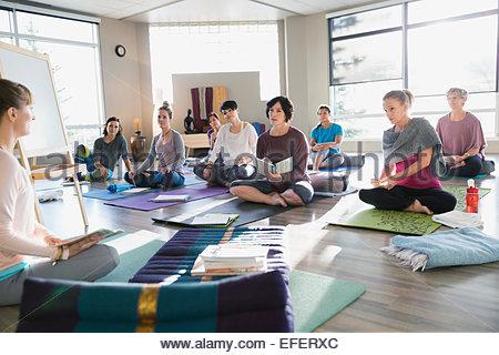Women with journals at restorative yoga retreat - Stock Photo