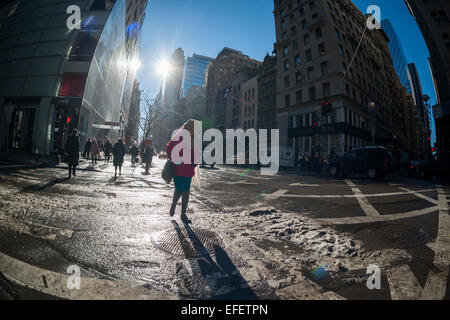 Pedestrian cross streets on Fifth avenue on Wednesday, January 28, 2015 as the city returns to normalcy after the - Stock Photo