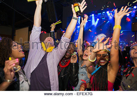 Friends enjoying New Year celebration in nightclub - Stock Photo