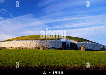 Newgrange Neolithic Passage Tomb in Co. Meath Ireland,  with Cirros clouds. Winter Solstice sun penetrates to the - Stock Photo