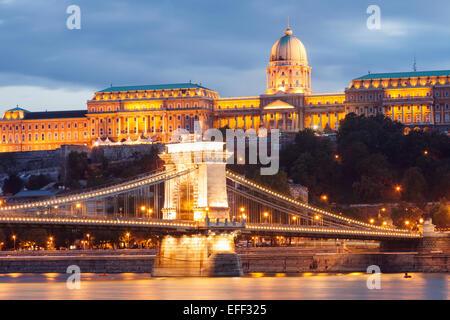 Royal Palace (18th c) and Chain Bridge at night. Budapest, Hungary - Stock Photo