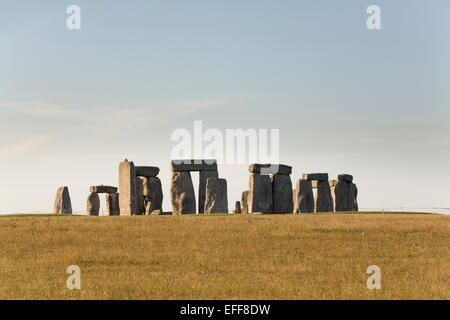 Stonehenge - prehistoric monument in Wiltshire England across brown grass field - Stock Photo