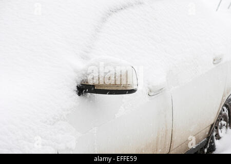 Car covered in snow after winter snowfall. - Stock Photo