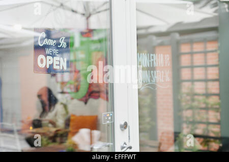Open sign hanging on entrance of cafeteria - Stock Photo