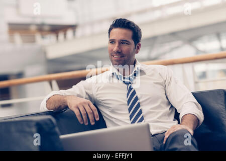 Portrait of a businessman relaxing - Stock Photo