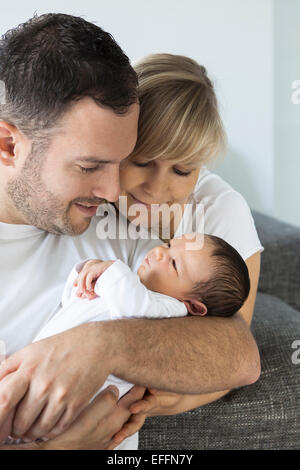 Young couple with newborn baby boy at home - Stock Photo