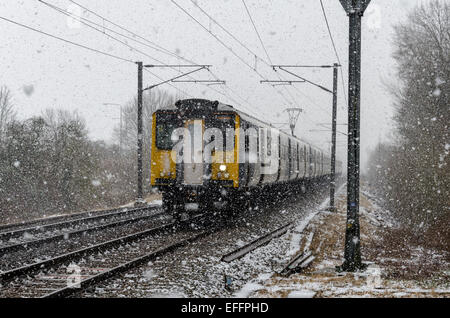 Sawston, Cambridge, UK. 3rd February 2015. UK Weather: A northbound train on the London Liverpool Street to Cambridge - Stock Photo